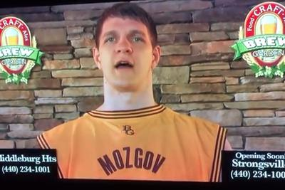 Timofey Mozgov sells alcohol while wearing jersey backwards