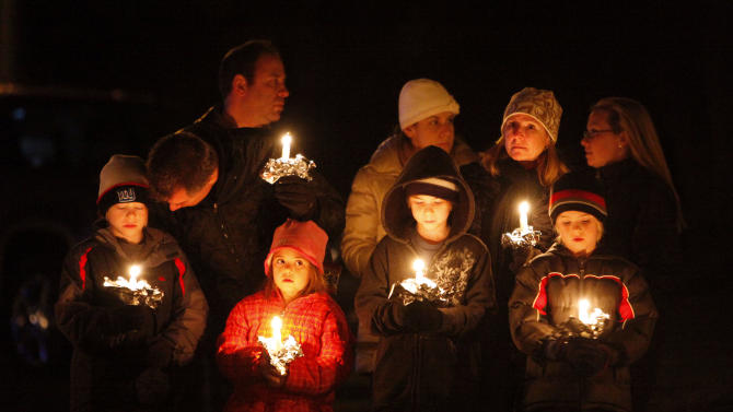 "CAROLINE PREVIDI, 6: ""Caroline Phoebe Previdi was a blessing from God and brought joy to everyone she touched,"" her parents, Jeff and Sandy Previdi, said in a statement. ""We know that she is looking down on us from heaven."" ----  Mourners gather for a candlelight vigil at Ram's Pasture to remember the shooting victims, Saturday, Dec. 15, 2012 in Newtown, Conn. (AP Photo/Jason DeCrow)"