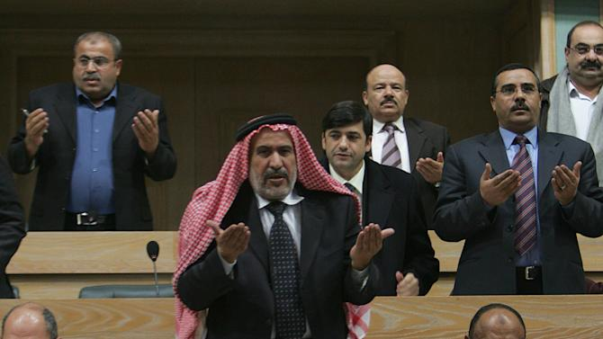 FILE- Jordanian law makers, no names available, recite verses from the Quran during a session for the Jordanian Parliament, in this Sunday, Jan. 7, 2007 file photo. Jordan's powerful Muslim Brotherhood said Friday, July 13, 2012 that it will boycott the upcoming parliamentary elections in protest over recent changes in the kingdom's election legislation, saying they fall short of the opposition group's demands. (AP Photo/Mohammad abu Ghosh, File)