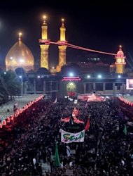<p>Shiite Muslims gather outside the shrine of Imam Abbas in Karbala early on Sunday. 30,000 security forces personnel have been deployed at the northern, southern and eastern entrances of Karbala to protect the pilgrims.</p>