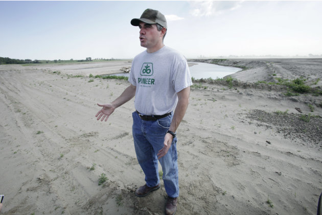 In this photo taken May 22, 2012, farmer Mason Hansen talks about the damage in his sand-covered farm field in Missouri Valley, Iowa. Hundreds of farmers in Iowa and Nebraska are still struggling to r
