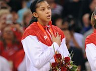 Candace sings the national anthem after receiving a gold medal in the Beijing Olympics. Getty Images.