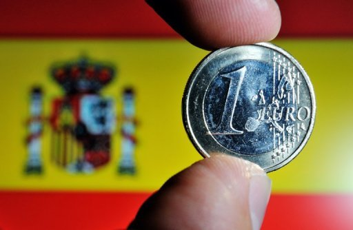 &lt;p&gt;A picture taken in May shows a coin of euro with a Spanish national flag in the background. Spain&#39;s recession is deepening with economic output sliding at a &quot;significant pace&quot; in the third quarter of this year, the Bank of Spain said Wednesday.&lt;/p&gt;