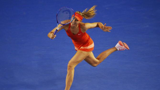 Sharapova of Russia hits a return to Williams of the U.S. during their women's singles final match at the Australian Open 2015 tennis tournament in Melbourne