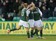 Leigh Griffiths, centre, celebrates after scoring in the victory over St Mirren