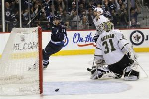 Ladd scores twice in Jets' 5-2 win over Stars