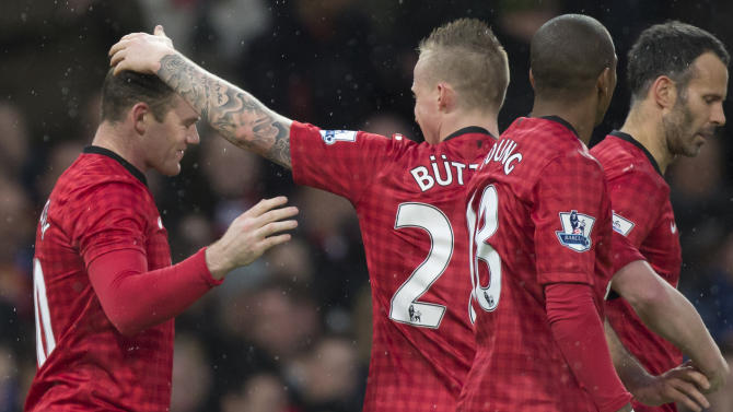 Manchester United's Wayne Rooney, left, celebrates with teammates after scoring against Reading during their English Premier League soccer match at Old Trafford Stadium, Manchester, England, Saturday March 16, 2013. (AP Photo/Jon Super)