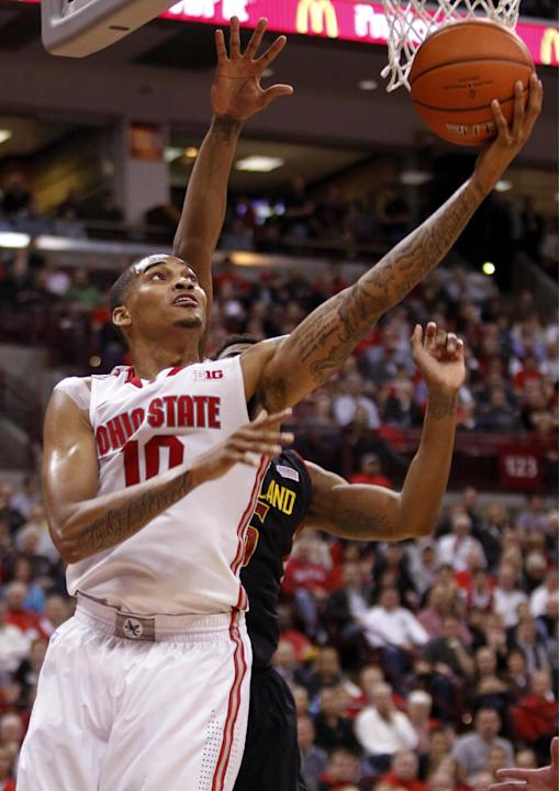 Ohio State's LaQuinton Ross, left, goes up for a shot against Maryland's Nick Faust during the first half of an NCAA college basketball game in Columbus, Ohio, Wednesday, Dec. 4, 2013. ( AP Ph