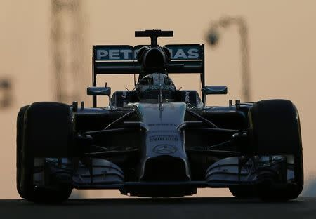 Mercedes Formula One driver Lewis Hamilton of Britain leaves the pit during the Abu Dhabi F1 Grand Prix at the Yas Marina circuit in Abu Dhabi