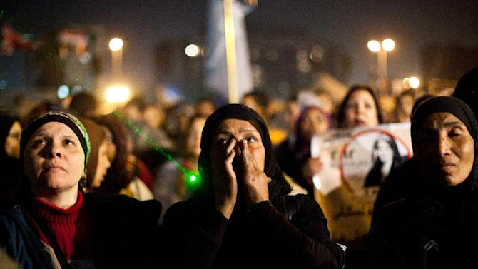 """Egyptian women gather to denounce sexual violence and harassment against women in Cairo, Egypt, Wednesday, Feb. 6, 2013. Mob-led sexual assaults targeting Egypt's female protesters could increase if perpetrators are not punished, an international rights group warned on Wednesday. Amnesty International said statements from victims show that the assaults follow a """"clear pattern,"""" where mobs of men encircle the victims, assault them with weapons and hands and then try to undress them. Amnesty's warning followed a statement from the U.N. human rights office, which last week said that about 25 women were reportedly sexually assaulted — in some cases with extraordinary violence — in Cairo's Tahrir Square during recent demonstrations against Egypt's Islamist President Mohammed Morsi. (AP/Virginie Nguyen Hoang"""