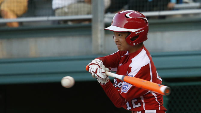Japan's Shozo Kamata hits an RBI-single during the fifth inning of an International double elimination baseball game against Mexico at the Little League World Series, Sunday, Aug. 17, 2014, in South Williamsport, Pa. Japan won 9-5. (AP Photo/Matt Slocum)