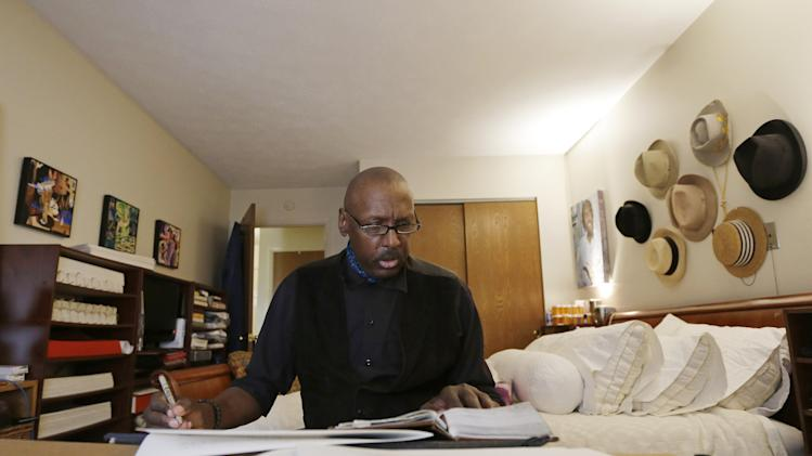 FILE - In this Tuesday, April 30, 2013  file photo, Phillip Patterson transcribes the King James Bible at this home in Philmont, N.Y. Patterson, a 63-year-old upstate New York man who has spent years writing out every word in the Bible has penning the very last lines. Patterson completed the final lines of the Book of Revelation on Saturday evening, May 11, 2013 during a ceremony at St. Peter's Presbyterian Church in Spencertown, near the Massachusetts border.(AP Photo/Mike Groll, File)