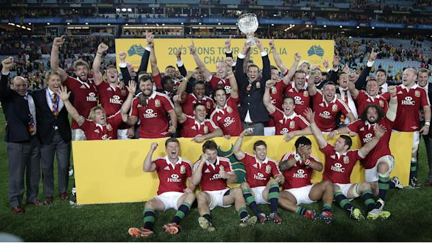 In this Saturday July 6, 2013 file photo, British and Irish Lions' team players celebrate their win over Australia in the final match of their 3-game rugby union test match series in Sydney, Austr