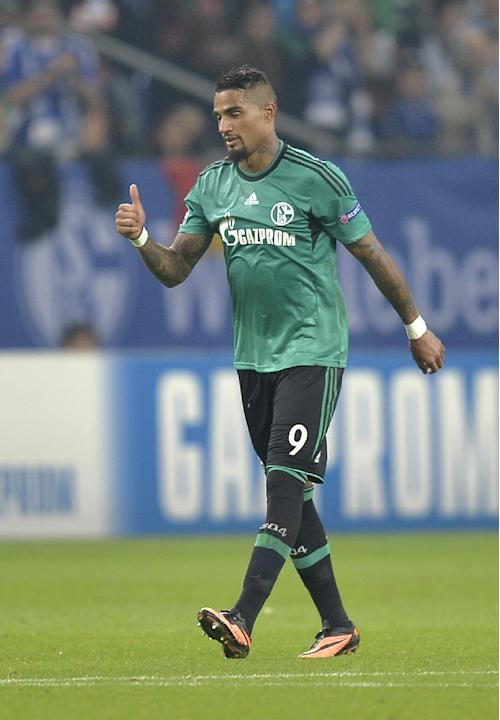Schalke's Kevin-Prince Boateng, right, celebrates after scoring his team's second goal during the Champions League Group E soccer match between FC Schalke 04 and Steaua Bucharest  in Gelsenkirchen, Ge