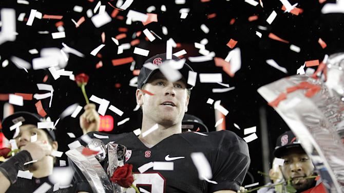 Stanford quarterback Kevin Hogan celebrates with the game MVP trophy after a 27-24 win over UCLA during the Pac-12 championship NCAA college football game in Stanford, Calif., Friday, Nov. 30, 2012.  The Cardinal will play the winner of the Big Ten title game between Nebraska and Wisconsin in the Rose Bowl on Jan. 1. (AP Photo/Tony Avelar)