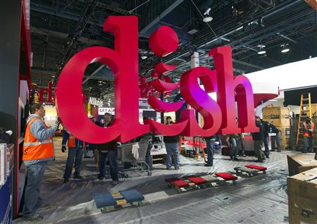 Workers build a booth for Dish, a satellite TV provider, as they prepare for the International CES show at the Las Vegas Convention Center in Las Vegas