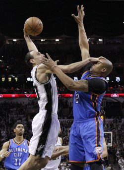Manu Ginobili (left) scored 19 points in the Spurs' Game 5 win. (AP)
