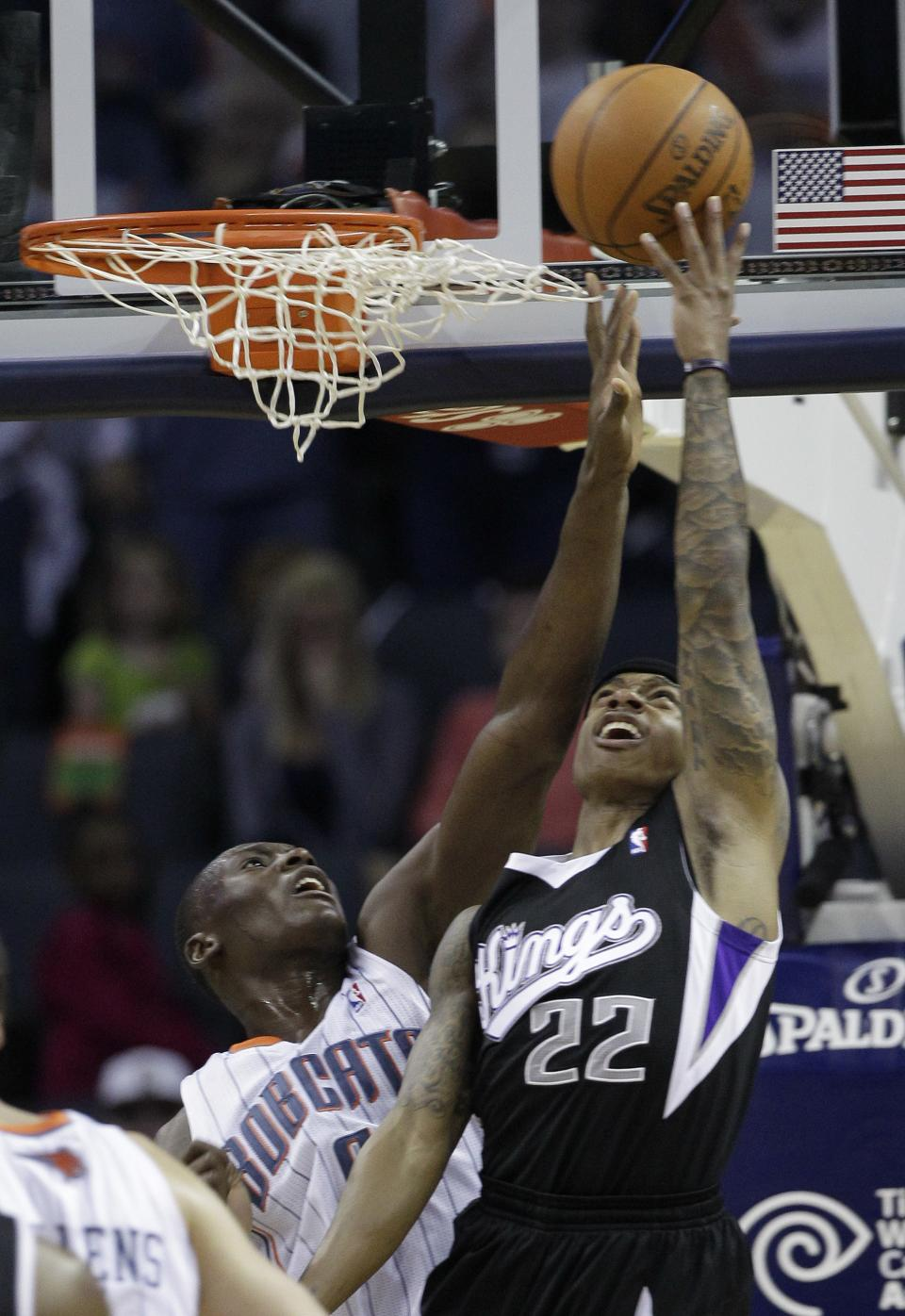 Sacramento Kings' Isaiah Thomas (22) shoots over Charlotte Bobcats' Bismack Biyombo (0) during the first half of an NBA basketball game in Charlotte, N.C., Sunday, April 22, 2012. (AP Photo/Chuck Burton)