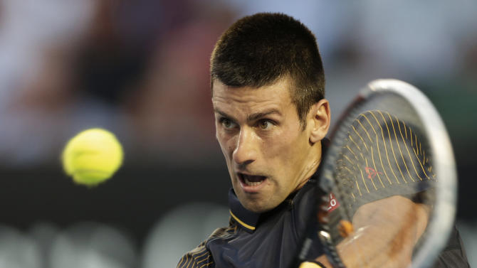 Serbia's Novak Djokovic hits a backhand return to Spain's David Ferrer during their semifinal match at the Australian Open tennis championship in Melbourne, Australia, Thursday, Jan. 24, 2013. (AP Photo/Andy Wong)