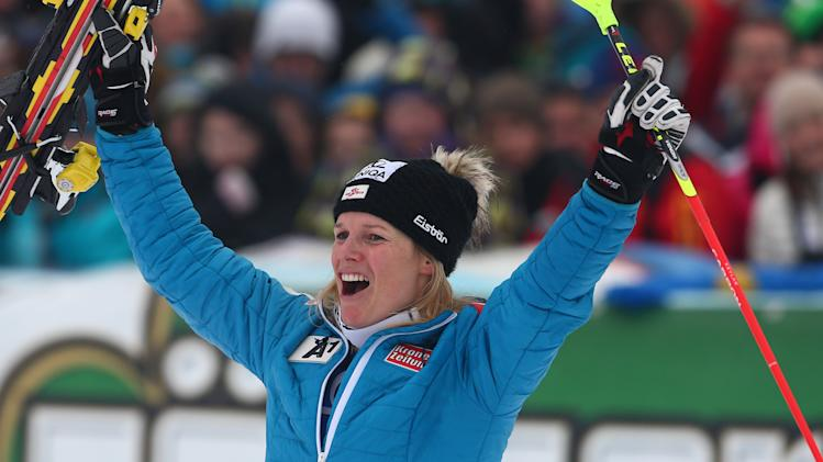 Austria's Marlies Schild celebrates after winning an alpine ski, women's World Cup slalom, in Lienz, Austria, Sunday, Dec. 29, 2013. (AP Photo/Giovanni Auletta)