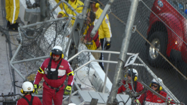 Emergency officials transport a fan who was hit by debris after Kyle Larson's car slammed into the wall and safety fence along the front grandstands on the final lap of the NASCAR Nationwide Series auto race at Daytona International Speedway in Daytona Beach, Fla., Saturday, Feb. 23, 2013.(AP Photo/Phelan M. Ebenhack)