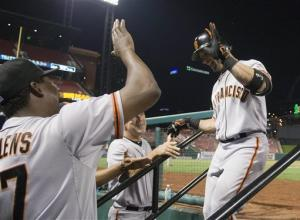 Scutaro hits slam, drives in 7 as SF routs Cards