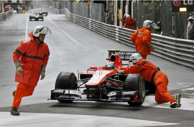 Marussia Formula One driver Max Chilton of Britain is assisted by track marshals during the qualifying session of the Monaco F1 Grand Prix