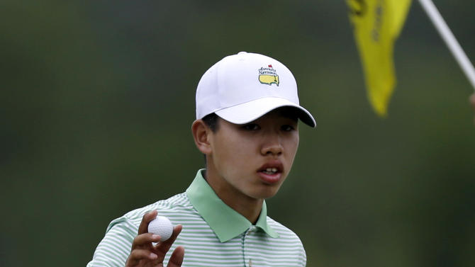 Guan Tianlang, 14 of China, acknowledges the gallery after making birdie on the seventh hole during the second round of the PGA Zurich Classic golf tournament at TPC Louisiana in Avondale, La., Friday, April 26, 2013. (AP Photo/Gerald Herbert)