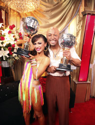 "In this image released by ABC-TV, war veteran and actor J.R. Martinez, right, and his partner Karina Smirnoff hold their awards after they were crowned champions of the celebrity dance competition series, ""Dancing with the Stars,"" Tuesday, Nov. 22, 2011 in Los Angeles. (AP Photo/ABC-TV, Adam Taylor)"