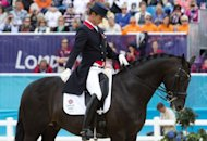 Britain&#39;s Carl Hester competes in the grand prix dressage event of the London 2012 Olympic Games at the equestrian venue in Greenwich Park in London. Britain won a 20th Olympic gold medal on Tuesday to make it the host nation&#39;s most successful Games in history