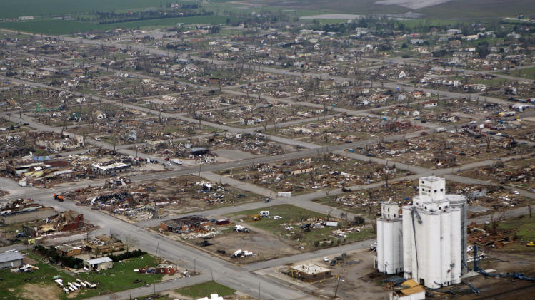 FILE - In this May 5, 2007 file photo, Widespread destruction in shown in Greensburg, Kan. after the city of 1,400 was ravaged by a F-5 tornado. Less than a week after one of the nation's deadliest tornadoes wiped a big chunk of Joplin, Missouri off the map, the city is beginning to shift its focus toward the next challenge: rising from the ruins. Not far from Joplin, Greensburg, Kan., rebuilt piece by piece after a 2007 twister leveled the town and killed 11.  (AP Photo/Orlin Wagner, File)