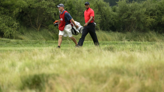 Tiger Woods, right, and caddie Joe LaCava walk to the 10th hole during the fourth round of the U.S. Open golf tournament at Merion Golf Club, Sunday, June 16, 2013, in Ardmore, Pa. (AP Photo/Gene J. Puskar)