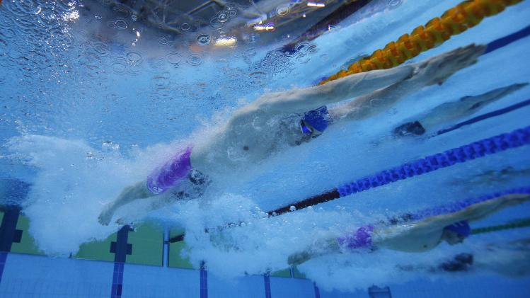 Murdoch of Scotland is seen underwater as he swims in the men's 200m Breaststroke final during the 2014 Commonwealth Games in Glasgow
