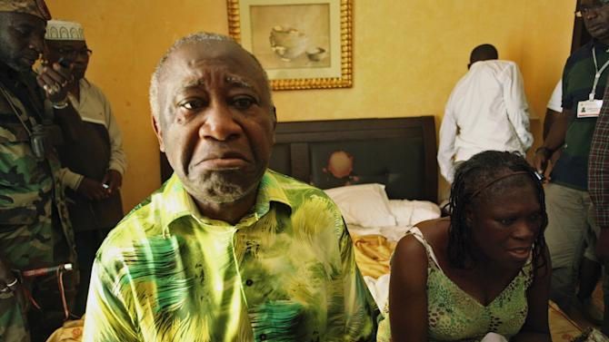 Ivory Coast's Laurent Gbagbo and his wife Simone sit in a room at Hotel Golf in Abidjan after they were arrested