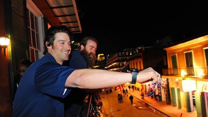 "Head & Shoulders new ""Mane Man"" L.A. Angels pitcher C.J. Wilson and Pittsburgh Steelers Brett Keisel celebrated the launch of new Head & Shoulders with Old Spice by throwing Mardi Gras beads on Bourbon Street from the balcony of famed Pat O'Brien's surrounding Super Bowl XLVII on Wednesday, Jan. 30, 2013 in New Orleans, LA. (Photo by Cheryl Gerber/Invision for Head & Shoulders/AP Images)"