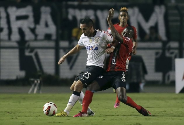 Augusto of Brazil's Corinthians challenges Riascos of Mexico's Tijuana during their Copa Libertadores soccer match in Sao Paulo