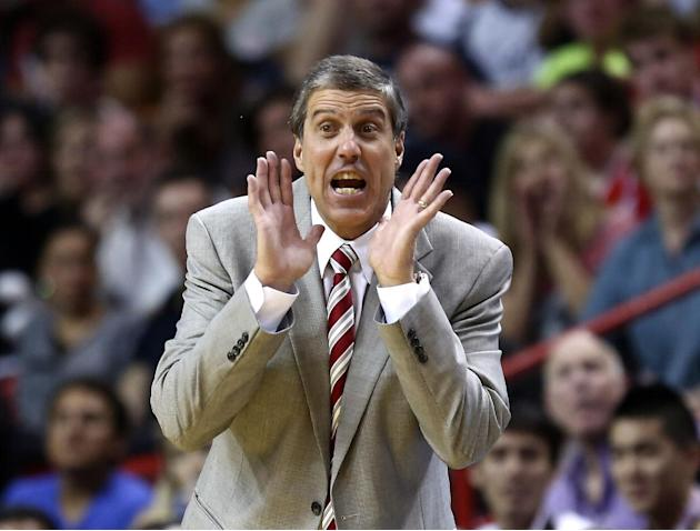 Washington Wizards coach Randy Wittman yells instructions to his team during the second half of an NBA basketball game against the Miami Heat in Miami, Monday, March 10, 2014. The Heat won 99-90