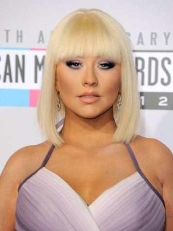 Christina Aguilera arrives at the 40th Anniversary American Music Awards on Sunday, Nov. 18, 2012, in Los Angeles. (Photo by Jordan Strauss/Invision/AP)