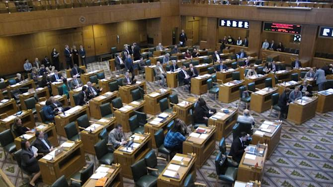 The Oregon House meets in Salem, Ore., on Friday, Dec. 14, 2012 to consider a tax deal requested by apparel giant Nike Inc., in exchange for bringing hundreds of new jobs. The governor called a special session that will cost taxpayers $13,000 a day, and is evidence of the lengths Oregon will go to protect its best-known company. (AP Photo/Jonathan J. Cooper)