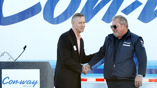 """IMAGE DISTRIBUTED FOR CON-WAY FREIGHT - Greg Lehmkuhl, president of Con-way Freight, left, congratulates James """"Jackpot"""" Sutfin for reaching three million accident-free miles on Monday, Feb. 11, 2013 in North Las Vegas, Nev. (Isaac Brekken / AP Images for Con-way Freight)"""