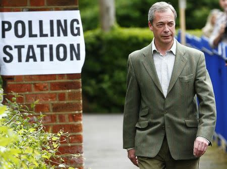 Nigel Farage, the leader of Britain's UKIP party arrives to vote in local and European elections at a polling station in Biggin Hill on the outskirts of London