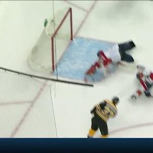 Tim Thomas dives out to make stick save