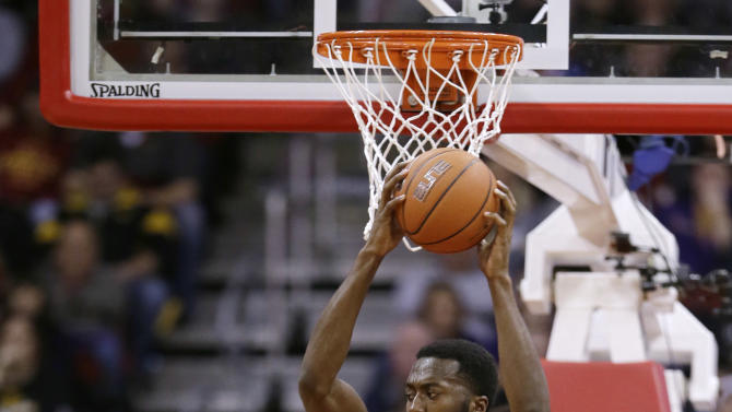 Iowa center Gabriel Olaseni (0) catches a pass over Northern Iowa guard Matt Bohannon (5) during the first half of an NCAA college basketball game, Saturday, Dec. 20, 2014, in Des Moines, Iowa. (AP Photo/Charlie Neibergall)