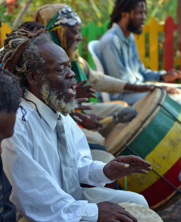 A Rastafarian drummer leads a chant during the celebration of reggae music icon Bob Marley's 68th birthday in the yard of his Kingston home, in Jamaica, Wednesday, Feb. 6, 2013. Marley's relatives and