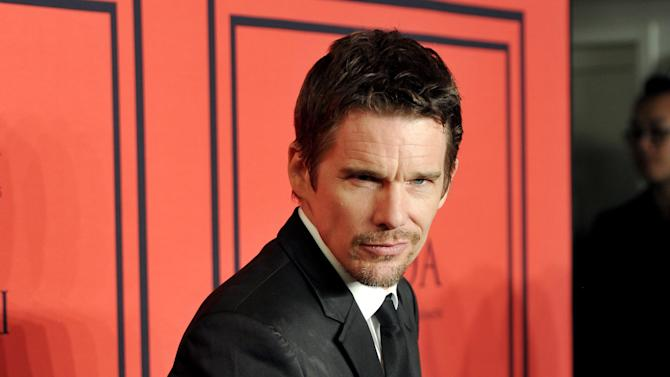 """FILE - This June 3, 2013 photo shows actor Ethan Hawke at the 2013 CFDA Fashion Awards at Alice Tully Hall in New York. Hawke will star in the Lincoln Center Theater production of """"Macbeth,"""" beginning performances on Thursday, October 24 in the Vivian Beaumont Theater in New York. (Photo by Evan Agostini/Invision/AP, file)"""