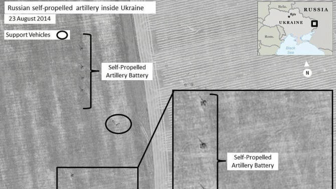This Aug. 23, 2014 satellite image made by DigitalGlobe and annotated by NATO shows what the military alliance says are Russian self-propelled artillery units near Krasnodon, Ukraine, inside territory controlled by Russian separatists. On Thursday, Aug. 28, 2014, senior NATO official, Brig. Gen. Nico Tak, said at least 1,000 Russian troops have poured into Ukraine with sophisticated equipment, leaving no doubt that the Russian military had invaded southeastern Ukraine. (AP Photo/NATO, DigitalGlobe)