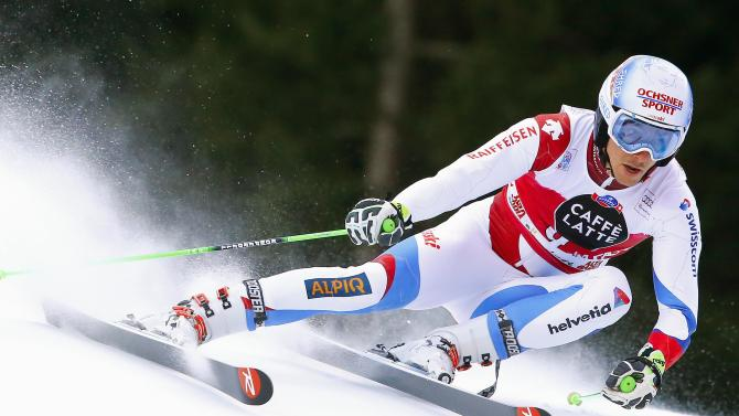 Janka of Switzerland clears a gate during the men's World Cup Giant Slalom skiing race in Alta Badia