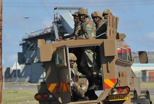 &lt;p&gt;South African army personnel sit on vehicle outside the strife-torn Lonmin mine on September 17. South African police fired rubber bullets at a crowd gathered near a platinum mine Wednesday, just a day after miners at another facility called off a wildcat strike that led to dozens of deaths.&lt;/p&gt;