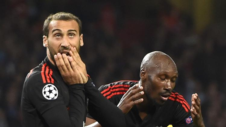 Besiktas' Tosun and Hutchinson react after a missed opportunity during their Champions League playoff soccer match against Arsenal at the Emirates stadium in London