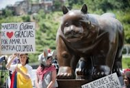 "Fernando Botero's bronze sculpture, ""El Gato"" (Spanish for cat), is unveiled during a ceremony in Colombia on April 2. His artistry and sculptures are seen in voluptuous, larger-than-life figures"